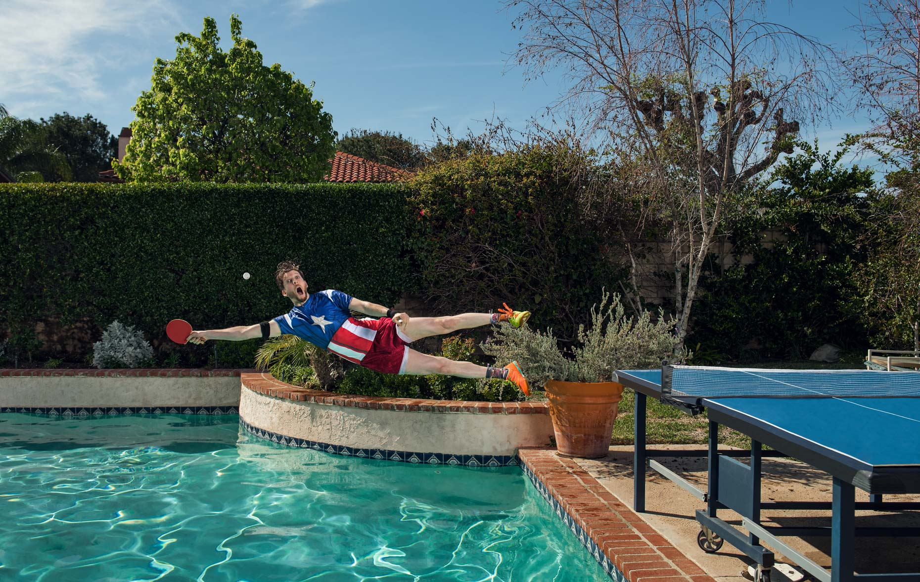Adam-bobrow-diving-shot-ping-pong-pool