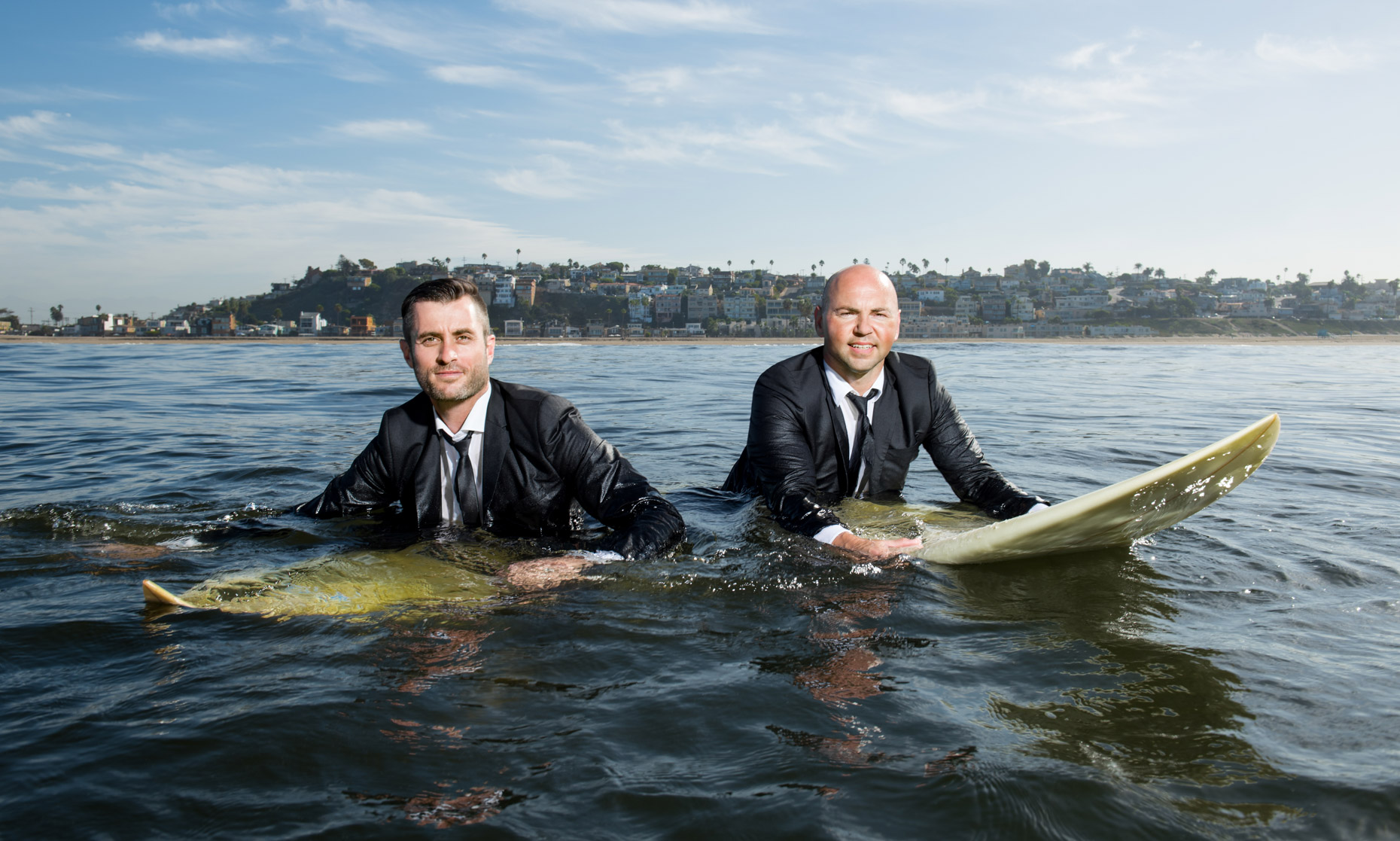 Swell-surfers-in-suits