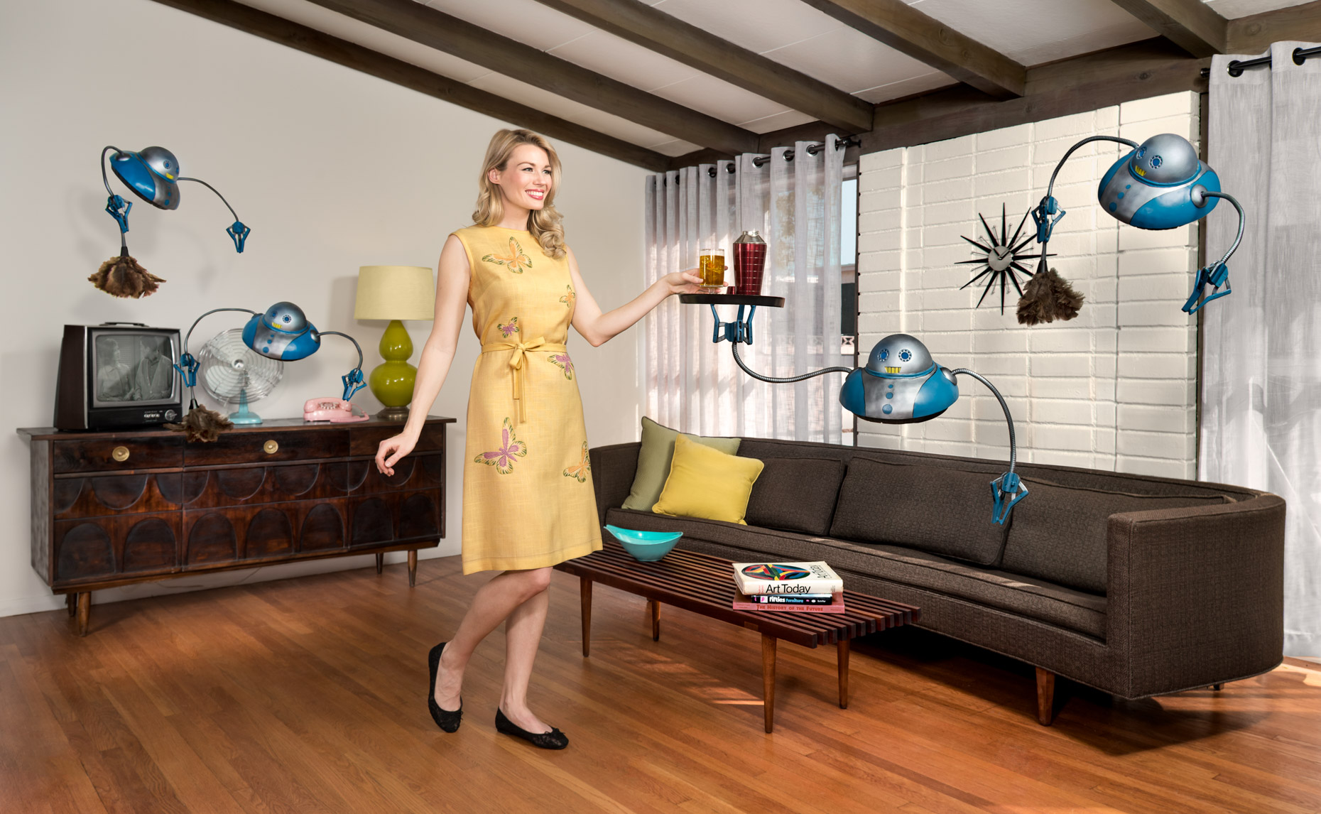 midentury-futuristic-lady-in-living-room-with-cleaning-robots